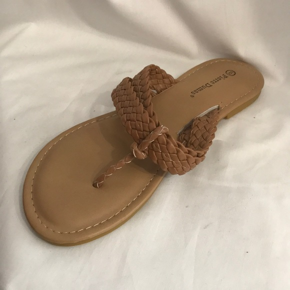 18184c0ad Tan woven flip flops